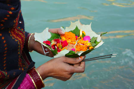puja: Puja ceremony on the banks of Ganga river in Haridwar, India