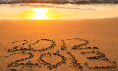 New Year 2013 is coming - inscription 2012 and 2013 on a beach sand  conceptual photo  photo