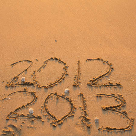 New Year 2013 is coming  - inscription 2012 and 2013 on a beach  photo
