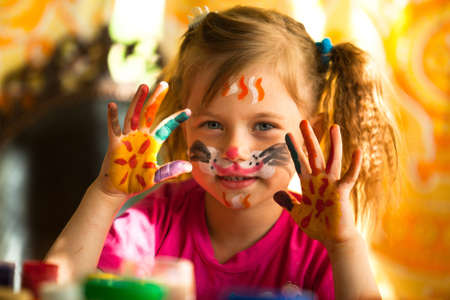 Little girl with paint of face Stock Photo - 17333394