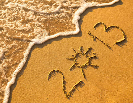 2013 written in sand on beach texture, soft wave of the sea  photo
