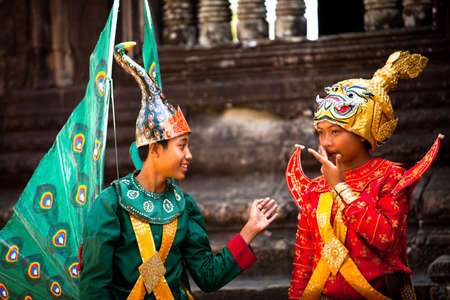 SIEM REAP, CAMBODIA - DEC 13: An unidentified cambodians in national dress poses for tourists in Angkor Wat, Dec 13, 2012 on Siem Reap, Cambodia. Angkor is the country's prime attraction for visitors. Stock Photo - 17808697