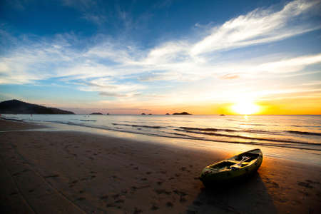 Kayak on the beach at sunset. Thailand. photo