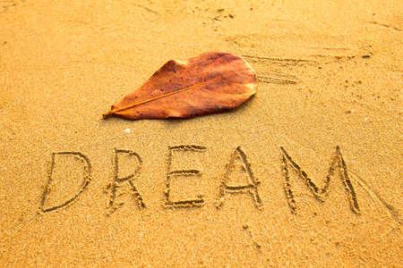 Texture on the sand  inscription Dream  photo
