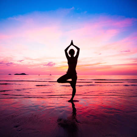 Young woman yoga practice at the seaside at sunset Stock Photo - 17643112