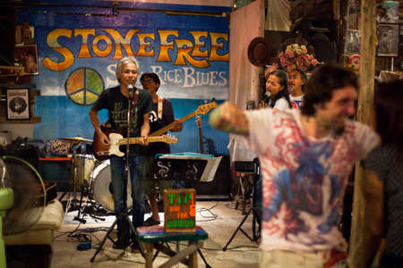 KO CHANGTRAT, THAILAND - FEBRUARY 10: Thai blues band Stone Free performing in a night club Sticky Rice Blues, February 10, 2013 on Koh Chang island, Thailand.
