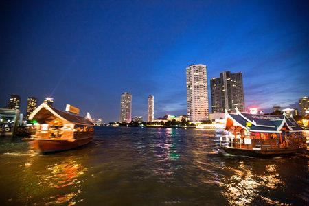 BANGKOK - APRIL 30: Water express bus plying the Chao Phraya River, April 30, 2012 on Bangkok. Fare 10-15 baht, intervals 5 min - does boat attractive alternative ground transportation. Stock Photo - 18114597