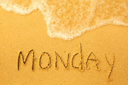 Monday - written in sand on beach texture - soft wave of the sea  days week series  Stock Photo