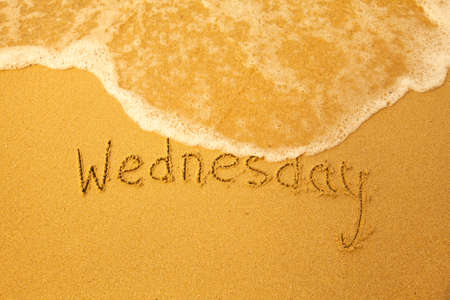 Wednesday - written in sand on beach texture - soft wave of the sea  days week series Stock Photo - 18026898