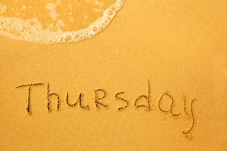thursday: Thursday - written in sand on beach texture - soft wave of the sea  days week series