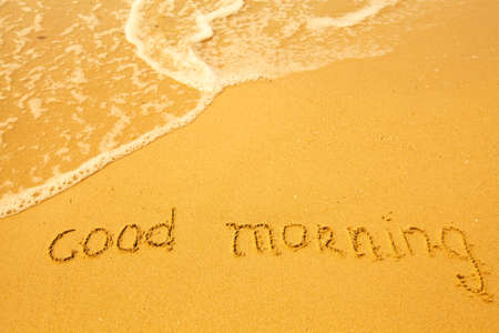 good heavens: Good morning - written in sand on beach texture - soft wave of the sea