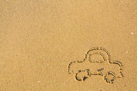 sand drawing: Car drawn on the beach sand