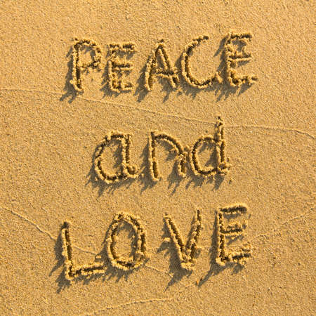 evoking: Peace and Love - drawn on the sand of a beach