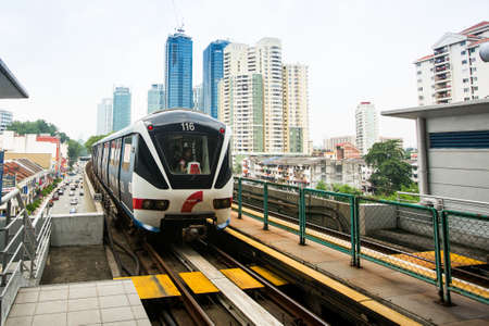 KUALA LUMPUR, MALAYSIA - MAR 30: Monorail train on Mar 30, 2013 in Kuala Lumpur, Malaysia. KL Monorail opened on 31 August 2003, and serves 11 stations running 8.6 km. Editorial