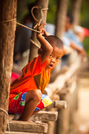 jah: BERDUT, MALAYSIA - APR 8: Unidentified child Orang Asli in his village on Apr 8, 2013 in Berdut, Malaysia. More than 76% of all Orang Asli live below the poverty line, life expectancy - 53 years old.