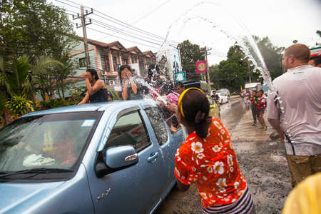 celebrated: KO CHANG, THAILAND - APR 13: People celebrated Songkran Festival, on 13 Apr 2013 on Ko Chang, Thailand. Songkran is celebrated in Thailand as the traditional New Year by throwing water at each other.