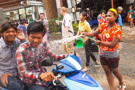 watergun: KO CHANG, THAILAND - APR 13: People celebrated Songkran Festival, on 13 Apr 2013 on Ko Chang, Thailand. Songkran is celebrated in Thailand as the traditional New Year by throwing water at each other.