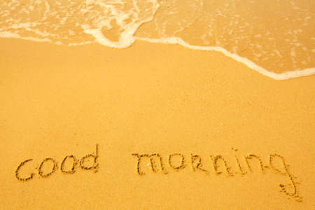 good heavens: Good morning - written in sand on beach texture.