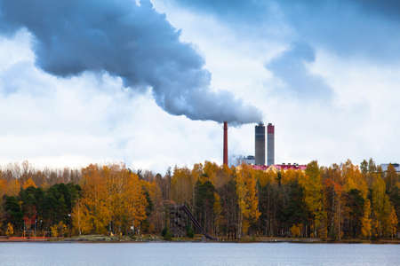 atmosphere construction: Air pollution by smoke coming out of three factory chimneys