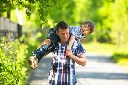 Father and son playing in the park photo