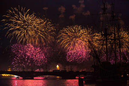 salut: ST.PETERSBURG, RUSSIA - JUNE 24: Celebration Scarlet Sails show during the White Nights Festival, June 24, 2013, St. Petersburg, Russia. From 2010, public attendance grew to 3 million.