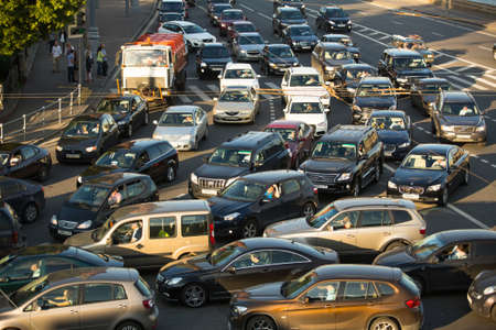 traffic jams: MOSCOW - JUNE 13: Cars stands in traffic jam on the city center, June 13, 2013, Moscow Russia. Moscow Mayor Sobyanin reconstructs suburban railways, to solve problem of traffic jams in 2016.