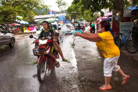 watergun: KO CHANG, THAILAND - APR 14: People celebrated Songkran Festival, on 14 Apr 2013 on Ko Chang, Thailand. Songkran is celebrated in Thailand as the traditional New Year by throwing water at each other.