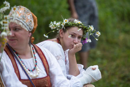 TERVENICHI, RUSSIA - JUL 7: Unidentified girl during Ivan Kupala Day, Jul 7, 2013, Tervenichi, Russia. The celebration relates to the summer solstice and includes a number of fascinating Pagan rituals