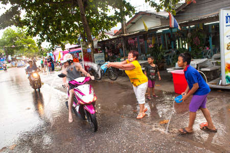 celebrated: KO CHANG, THAILAND - APR 14: People celebrated Songkran Festival, on 14 Apr 2013 on Ko Chang, Thailand. Songkran is celebrated in Thailand as the traditional New Year by throwing water at each other.