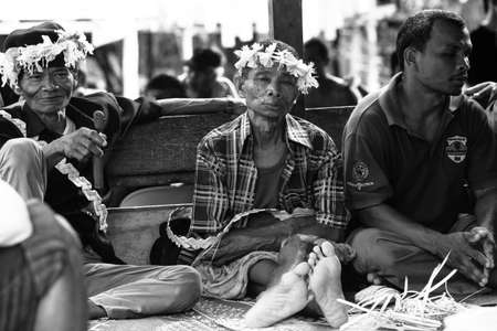 jah: BERDUT, MALAYSIA - APR 8: Unidentified people Orang Asli during a ceremonial dinner in his village (bw photo) on Apr 8, 2013 in Berdut, Malaysia. More than 76% of all Orang Asli live below the poverty line.