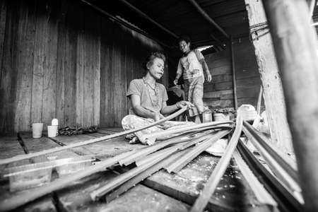 jah: BERDUT, MALAYSIA - APR 8: Unidentified woman Orang Asli in his village (bw photo) on Apr 8, 2013 in Berdut, Malaysia. More than 76% of all Orang Asli live below the poverty line, life expectancy - 53 years old. Editorial