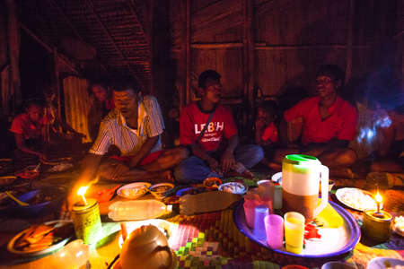jah: BERDUT, MALAYSIA - APR 8: Unidentified people Orang Asli during a ceremonial dinner in his village on Apr 8, 2013 in Berdut, Malaysia. More than 76% of all Orang Asli live below the poverty line. Editorial