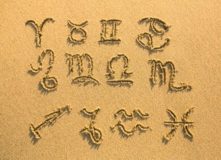 Set of zodiac signs (drawn on the facture beach sand) photo