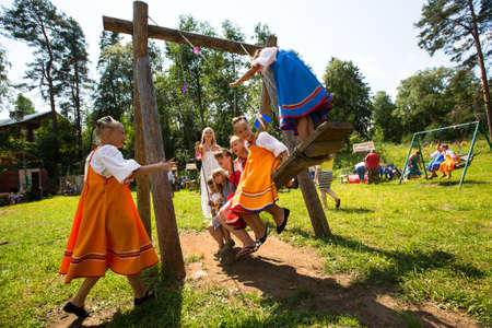relates: TERVENICHI, RUSSIA - JUL 7: Unidentified girl during Ivan Kupala Day, Jul 7, 2013, Tervenichi, Russia. The celebration relates to the summer solstice and includes a number of fascinating Pagan rituals