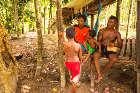 BERDUT, MALAYSIA - APR 8: Unidentified children Orang Asli in his village on Apr 8, 2013 in Berdut, Malaysia. More than 76% of all Orang Asli live below the poverty line, life expectancy - 53 years old.