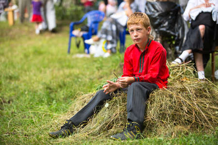 relates: TERVENICHI, RUSSIA - JUL 7: Unidentified boy during Ivan Kupala Day, Jul 7, 2013, Tervenichi, Russia. The celebration relates to the summer solstice and includes a number of fascinating Pagan rituals Editorial