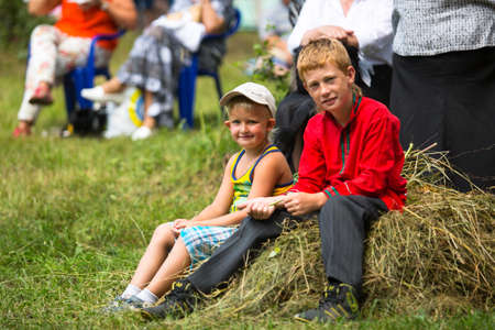 relates: TERVENICHI, RUSSIA - JUL 7: Unidentified boys during Ivan Kupala Day, Jul 7, 2013, Tervenichi, Russia. The celebration relates to the summer solstice and includes a number of fascinating Pagan rituals Editorial