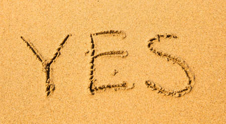 Yes - written in sand on beach texture. photo