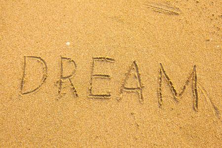 Dream - Inscription on the sand texture. photo