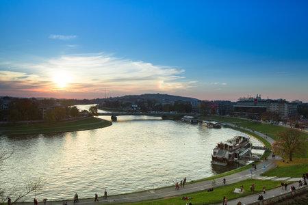 kilometres: KRAKOW, POLAND - OCT 19: View of the embankment of Vistula River in the historic city center, Oct 19, 2013 in Krakow, Poland. Vistula is the longest river in Poland, at 1,047 kilometres (651 miles) in length.