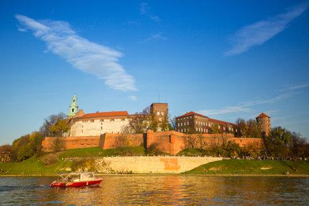 kilometres: KRAKOW, POLAND - OCT 20: View of Royal Wawel castle and Vistula river, Oct 20, 2013 in Krakow, Poland. Vistula is the longest river in Poland, at 1,047 kilometres in length.
