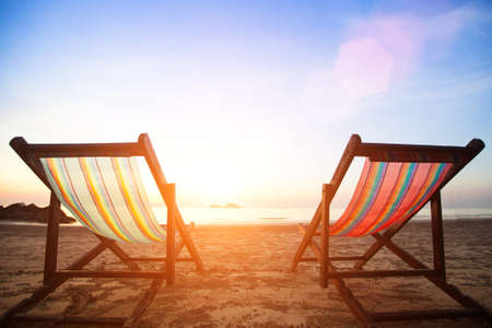 two chairs: Beach chairs on the evening sea coast. Stock Photo