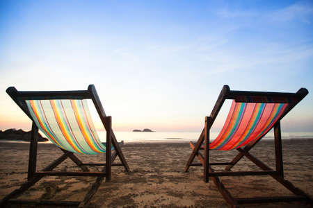 Beach chairs on sea coast. photo
