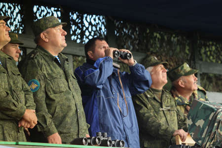 airborne: KOSTROMA REGION - AUG 26: Vladimir Shamanov (L) (Commander-in-Chief Russian Airborne Troops) during Command post exercises with 98-th Guards Airborne Division, Aug 26, 2010 in Kostroma region, Russia.