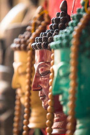 singing bowls: Closeup: Handicrafts in Nepal (Buddha heads)