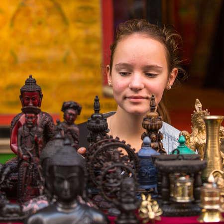 singing bowls: Teen-girl in a souvenir shop in Kathmandu.