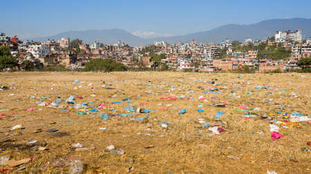 recycle area: Debris on the field of view of panorama Kathmandu in the background. Environmental problems.