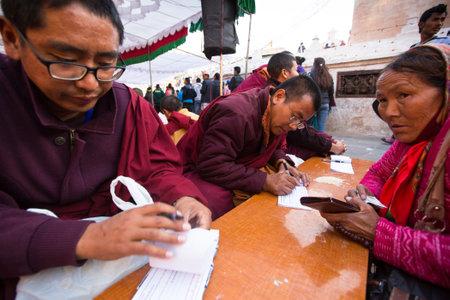 padma: KHATMANDU, NEPAL - DEC 15: Unidentified tibetan Buddhist monks near stupa Boudhanath during festive Puja of H.H. Drubwang Padma Norbu Rinpoches reincarnations, Dec 15, 2013 in Khatmandu, Nepal. Editorial