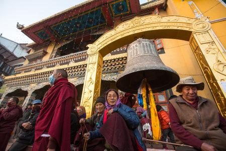 padma: KHATMANDU, NEPAL - DEC 15: Unidentified Buddhist pilgrims near stupa Boudhanath during festive solemn Puja of H.H. Drubwang Padma Norbu Rinpoches reincarnations, Dec 15, 2013 in Khatmandu, Nepal. Editorial