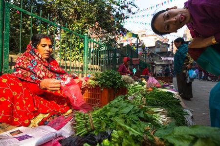 KATHMANDU, NEPAL - NOV 28: Unidentified street vendor in historic center of city, Nov 28, 2013 in Kathmandu, Nepal. Largest city of Nepal, its historic center, a population of over 1 million people.